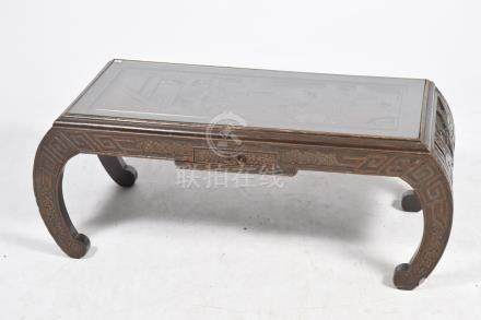 A carved hardwood Kang table, 20th Century The rectangular top carved in deep relief depicting
