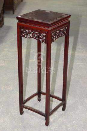 A Chinese rosewood jardiniere stand, 20th Century Having a square top above a scrolling dragon