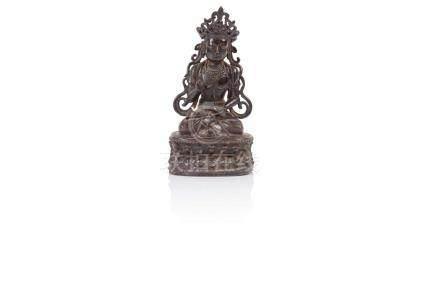 Statuette de bouddha Chine - Époque Ming (1368 - 1644) Bronze à patine brune,