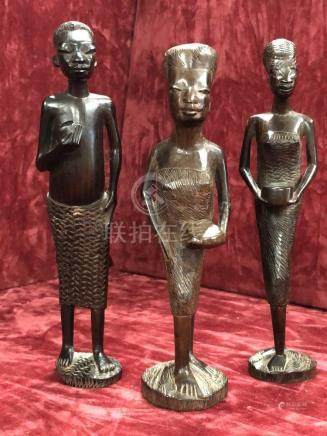 A group of three African carved wooden tribal figures