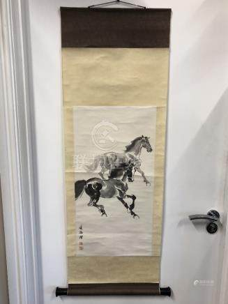 A Chinese scroll depicting two galloping horses signed to the side