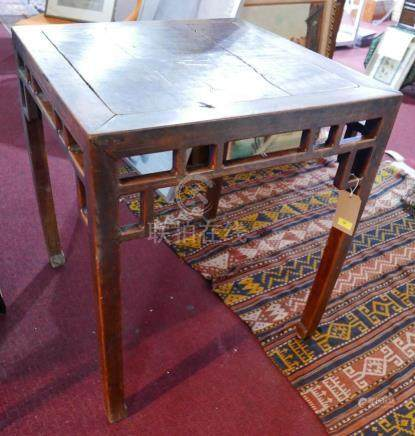A late 18th/early 19th century Chinese hardwood table, with carved frieze raised on shaped legs, H.