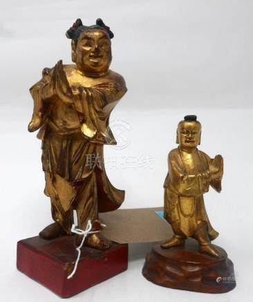 An early 19th century Chinese carved giltwood figure, H.13cm, together with a mid 19th century