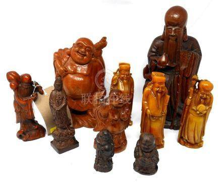 A carved wooden Buddha figure, 6 others similar and 3 similar resin figures H 29cm
