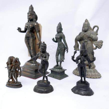 A figure of a Hindu goddess and 5 similar smaller figures H 23cm