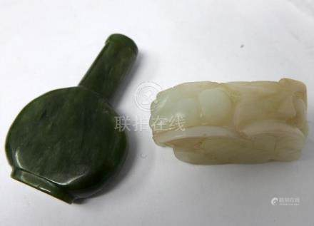 A Chinese green jade scent bottle, H.6cm, together with a Chinese carved white jade chopstick rest