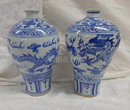PAIR CHINESE BLUE & WHITE POTTERY VASES DECORATED WITH DRAGONS,