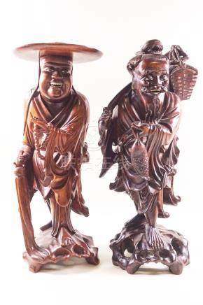 Two Japanese root carved figures, one holding a fish and a knap sack and another