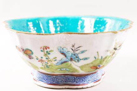 A Canton enamel bowl, painted with butterflies in a landscape, with Daoguang mark,