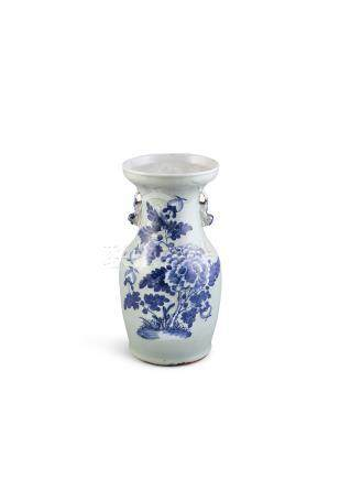 A CHINESE CELADON GROUND VASE, c.1900 with flared rim, the body decorated with stylised peonies
