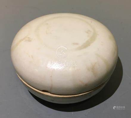 A Sung dynasty lidded powder box with faded pattern. Diameter 9.5cm.