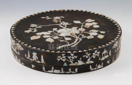 A Chinese circular cosmetic box, the lid having a mother of pearl floral design with edge of box