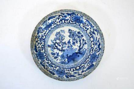 A Chinese blue and white plate, Kangxi, relief moulded ribbe