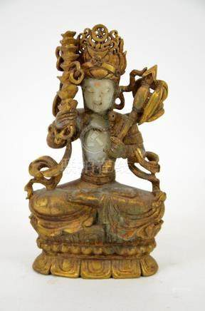 A Chinese gilt jade and bronze figure of a Buddhist deity, m
