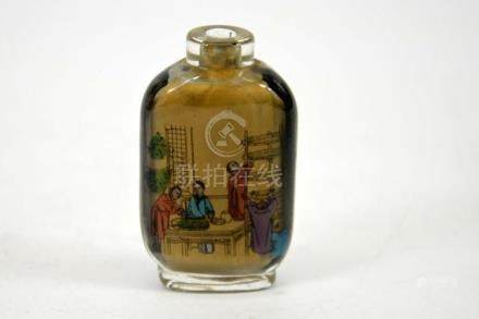 A Chinese reverse painted glass snuff bottle, an interior co