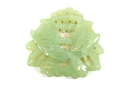 A Chinese carved jade pendant, reticulated and modelled as t