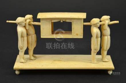 λ A 19th century Indian ivory figure group of a palanquin be