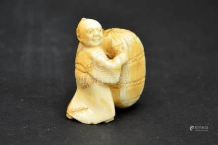 λ A 19th century Japanese carved ivory netsuke, Meiji, model