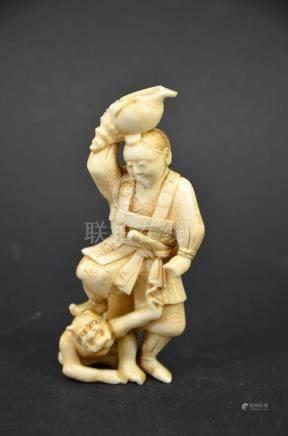 λ A 19th century Japanese carved ivory okimono, Meiji, model