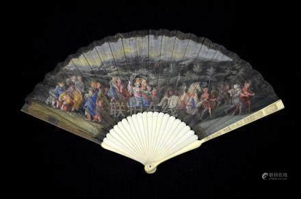 λ An early 18th century ivory fan, with ivory sticks and gua