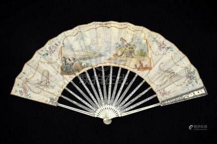 λ A late 18th century Dutch ivory fan with carved, pierced a