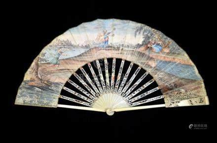 λ A late 18th century fan, the ivory guards and sticks carve