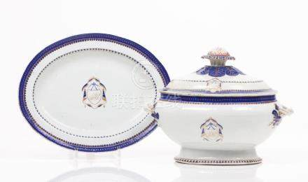 A pair of tureens with covers and dishes