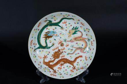 Chinese Art A porcelain dish painted with gilt red, green an