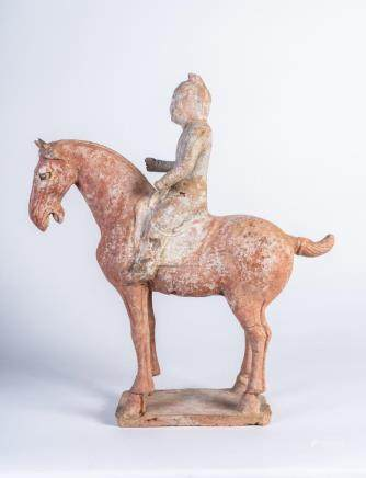 Chinese Art An earthenware funerary horse and rider China, T
