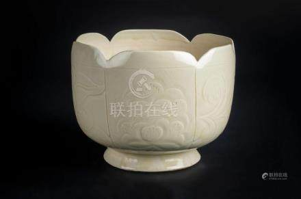 Chinese Art A white porcelain lobed footed cup with floral i