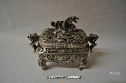 A Chinese white metal censor, the lidwith dragon, twin handles of dragon form, raised an bold