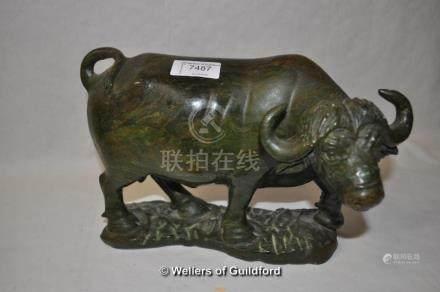 A carved soapstone figure of a cape buffalo, 23cm long.