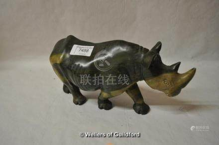 A carved soapstone figure of a rhinoceros, 26cm long.