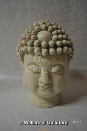 A Chinese blanc-de-chine portrait bust of a buddha with coiled hairstyle, 27cm.