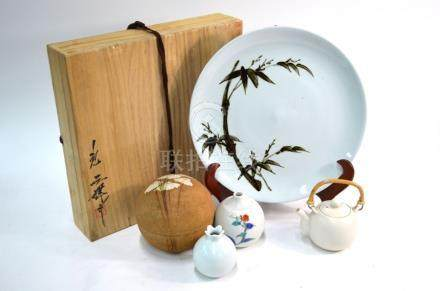 Five Shibui examples of modern Japanese ceramic design, comprising: a large circular dish with a