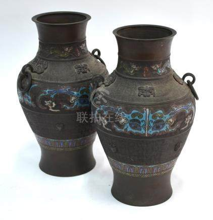 A pair of Japanese metal and enamel vases, decorated in the Chinese style with archaistic motifs and