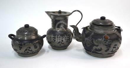 A Chinese pewter mounted service, comprising: teapot, sugar bowl and milk jug. the teapot marked