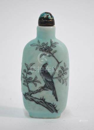 A Chinese snuff bottle, decorated with a stag beside a gnarled tree, and a bird perched beside