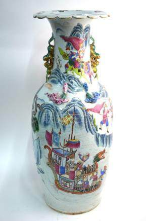 A Chinese Canton famille rose vase, decorated with Manchu/Chinese figures in narrative scenes, 60 cm