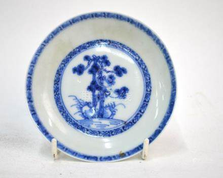 A small Chinese Export blue and white dish, decorated with a pine tree; 10 cm diameter; with