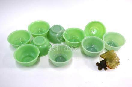 A set of ten Beijing, green glass bowls, each one 11 cm diameter; together with a Chinese bowenite