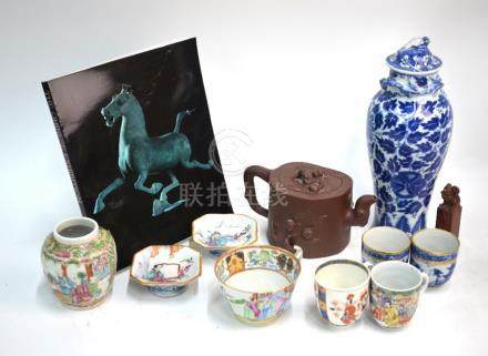 A quantity of Chinese Ceramics, comprising: a Yixing teapot and cover, 18 cm wide; a blue and
