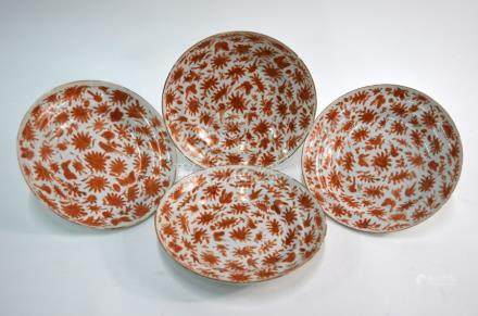 A set of four rouge-de-fer decorated, Chinese Export shallow soup dishes; each one designed with