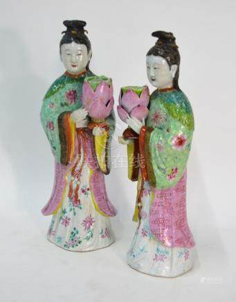 An elegant pair of famille rose figures; each one designed as a high ranking Manchu/Chinese lady