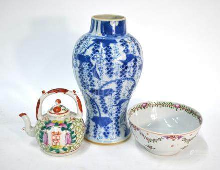A Chinese blue and white baluster vase, decorated with floral designs, 23 cm high; together with a