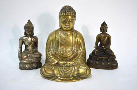 Three metal figures of Buddhistic Deities, comprising: a figure of Amitayus holding the alms bowl,