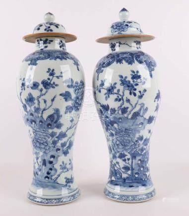 A pair of blue / white porcelain baluster-shaped lid vases,
