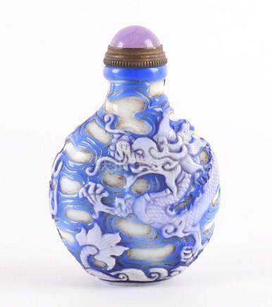 A blue / white overlay snuff bottle with decoration of five-