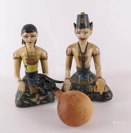 A pair of polychrome painted wooden Javanese wedding statues