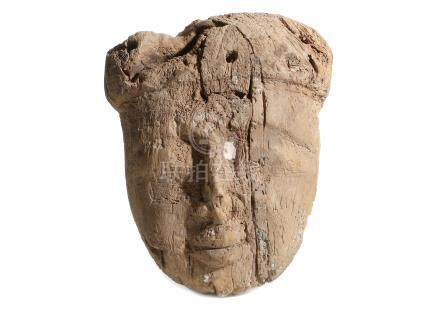 AN EGYPTIAN MUMMY MASK Late Period, 26th Dynasty - Ptolemaic Period The facial features carved in